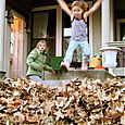 jumping in the leaf pile from the porch
